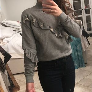 Grey ruffled sweater with hint of metallic